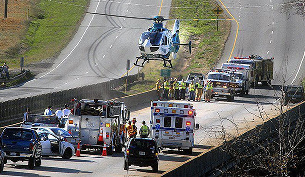 Medical helicopter at accident scene with EMS & Flight Safety Net Team